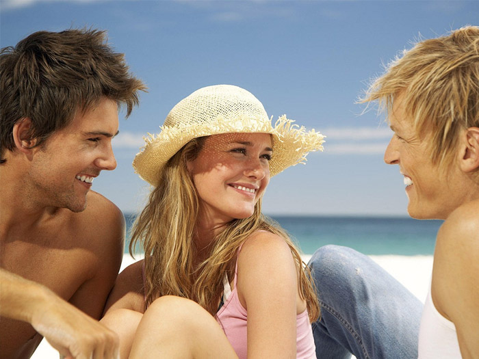 Girl with 2 guys on beach